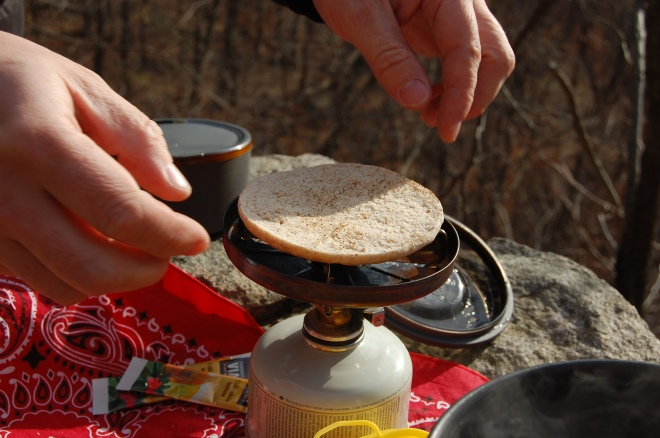 once you have sipped your scalding coffee and burned your tongue you can toast your bread - very carefully!! - over the open flame from your stove. Let it rest right on the pot supports quickly on one side…